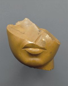 Fragment of a Queen's Face, New Kingdom, 18th dynasty, reign of Akhenaten.  From Middle Egypt, probably el-Amarna/Akhetaten (c. 1353–1336 BCE, yellow jasper, 5⅛ x 4⅞ x 4⅞ in [13 x 12.5 x 12.5 cm]).  The Metropolitan Museum of Art.  Photograph by Bruce White. © The Metropolitan Museum of Art.