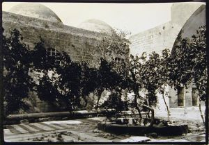 View of Interior Courtyard with Trees and Pool, Madrasa al-Firdaws. Photo © Creswell Archive, Ashmolean Museum, neg. EA.CA.5850. Image courtesy of Fine Arts Library, Harvard College Library.