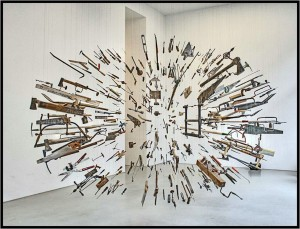 Displayed in art gallery. Damián Ortega, Controller of the Universe (2007, found tools and wire, dimensions vary). Collection of Glenn and Amanda Fuhrman, New York.